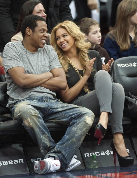 With Jay-Z, husband.